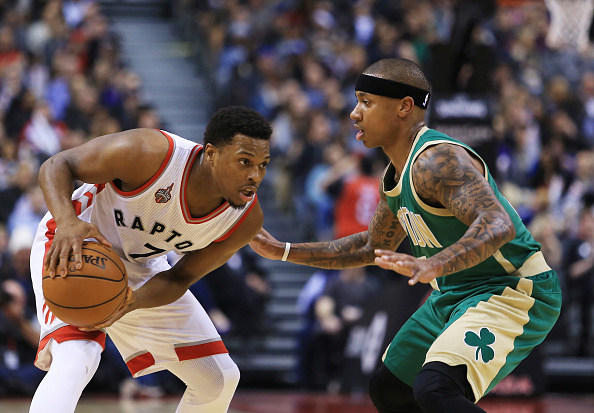 TORONTO, ON - MARCH 18:  Kyle Lowry #7 of the Toronto Raptors dribbles the ball as Isaiah Thomas #4 of the Boston Celtics defends during the second half of an NBA game at the Air Canada Centre on March 18, 2016 in Toronto, Ontario, Canada.  (Photo by Vaughn Ridley/Getty Images)