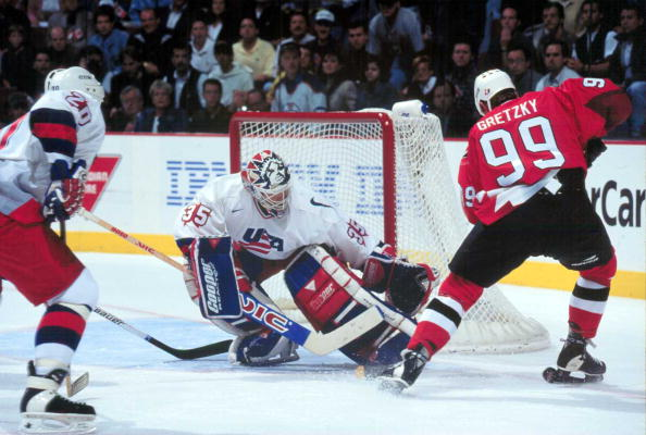 MONTREAL, QC - SEPTEMBER, 1996: Goalie Mike Richter #35 of the United States stops Wayne Gretzky #99 of Canada during the 1996 World Cup of Hockey in September, 1996 at the Molson Centre in Montreal, Quebec, Canada.  (Photo by Robert Laberge/Getty Images)