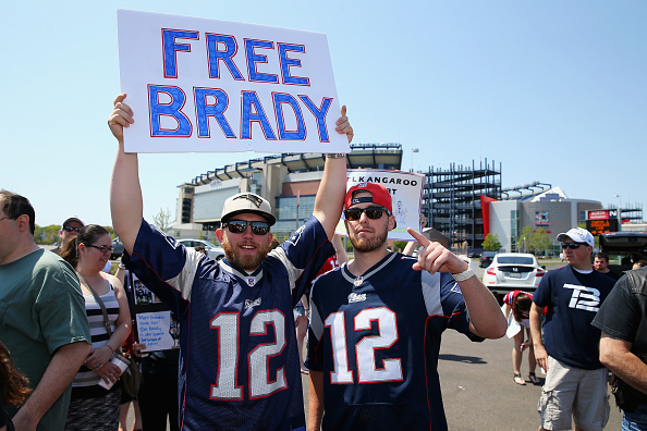 """FOXBORO, MA - MAY 24:  Ryan Desilets and Jon Harmon both from Milford, Massachusetts, show support for New England Patriots quarterback Tom Brady at the """"Free Tom Brady"""" rally at Gillette Stadium on May 24, 2015 in Foxboro, Massachusetts. The rally was held in protest of Brady's four game suspension for his role in the """"deflategate"""" scandal.  (Photo by Maddie Meyer/Getty Images)"""