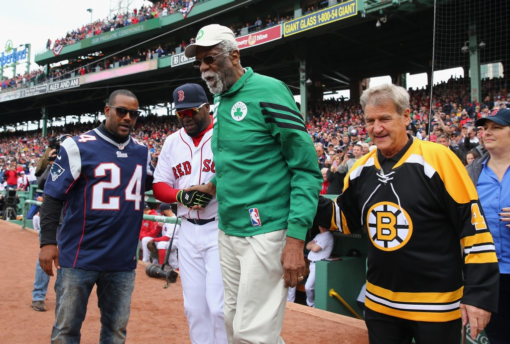 BOSTON, MASSACHUSETTS - APRIL 11:  (L-R) Former New England Patriots player Ty Law, David Ortiz #34 of the Boston Red Sox, former Boston Celtics player Bill Russell, and former Boston Bruins player Bobby Orr walk onto the field to throw a ceremonial first pitch prior to the home opener between the Boston Red Sox and the Baltimore Orioles at Fenway Park on April 11, 2016 in Boston, Massachusetts.  (Photo by Maddie Meyer/Getty Images)