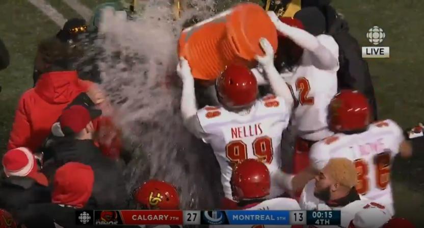 The Calgary Dinos' Vanier Cup win led to them dunking head coach Wayne Harris Jr.
